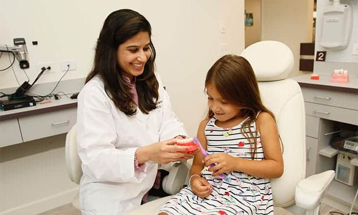 Dr. Bhave educating child patient