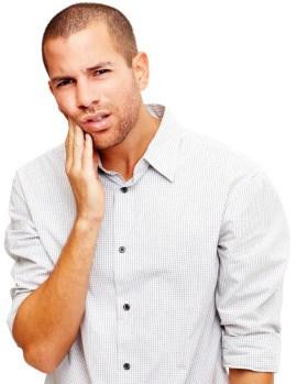 Man holding his cheek in discomfort