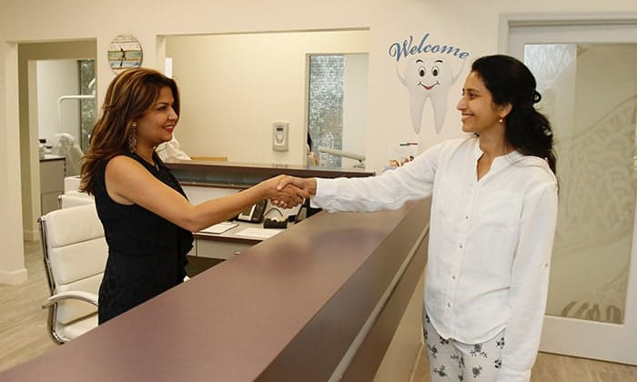 Receptionist greeting patient